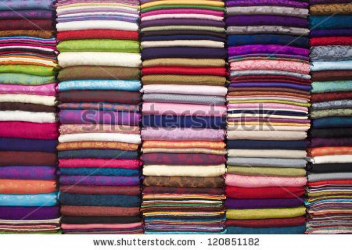 Stock-photo-colorful-stacked-fabric-in-a-big-market-in-hanoi-vietnam-120851182