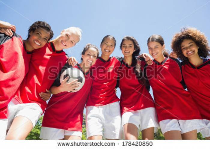 Stock-photo-portrait-of-confident-female-soccer-team-with-ball-against-clear-blue-sky-178420850