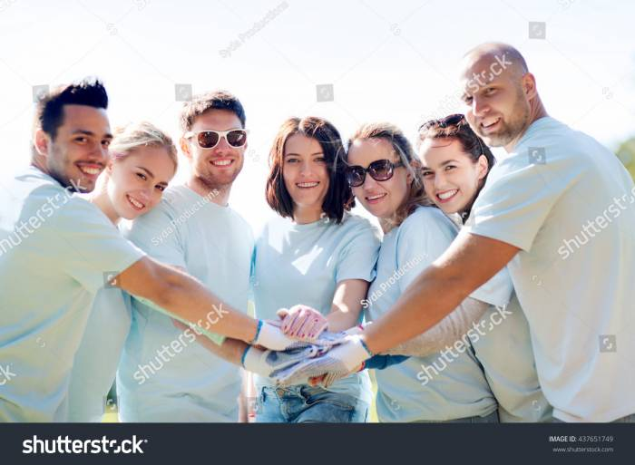 Stock-photo-volunteering-charity-people-gesture-and-ecology-concept-group-of-happy-volunteers-putting-437651749